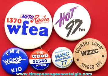(5) Different Radio Station Pin Back Buttons And (1) Wooden Nickel