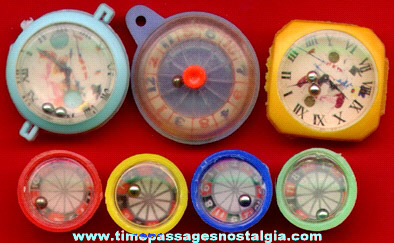 (7) Tiny Dexterity Puzzles And Roulette Wheel Toys