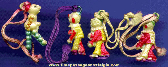 (4) 1930's Celluloid Clown Charms