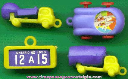 (4) Scarce Old Transportation Gum Ball Machine Charms