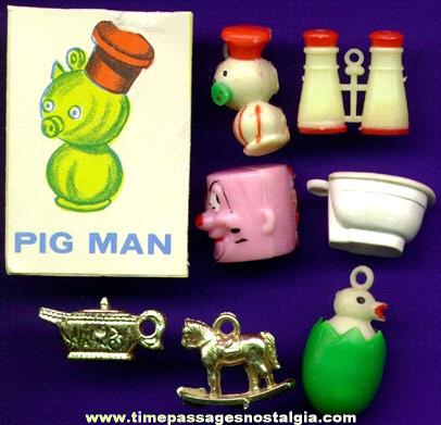 (7) Scarce 1960's Gumball Machine Charms Plus A Bonus!
