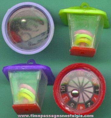 (4) 1960's Gum Ball Machine Dexterity Game Puzzle Prizes