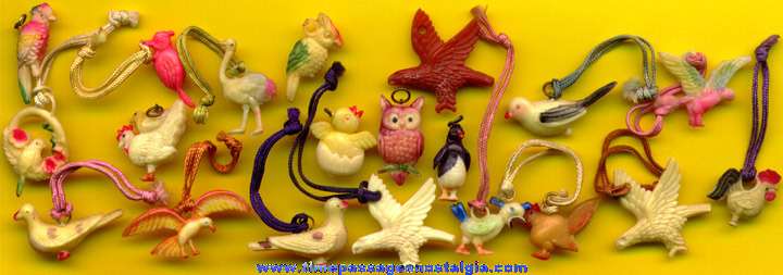 (20) Old Celluloid Bird Charms