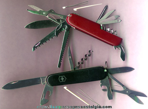(4) Different Swiss Army Knives
