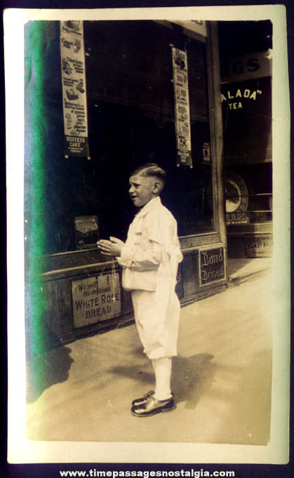 Old Storefront With Advertising Signs and Boy Photograph