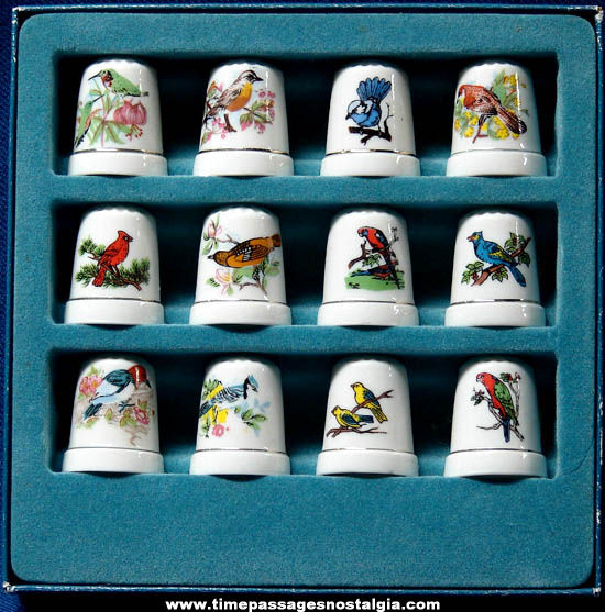 Set of (12) Boxed Porcelain Sewing Thimbles with Birds