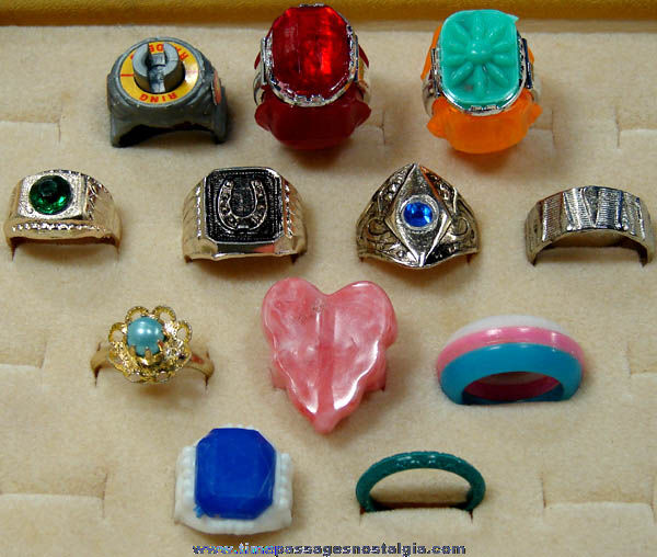 12 different old metal plastic gum ball machine prize toy rings