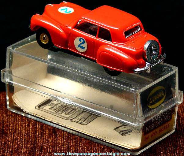 Boxed 1960s Red Lincoln Continental Aurora Slot Car