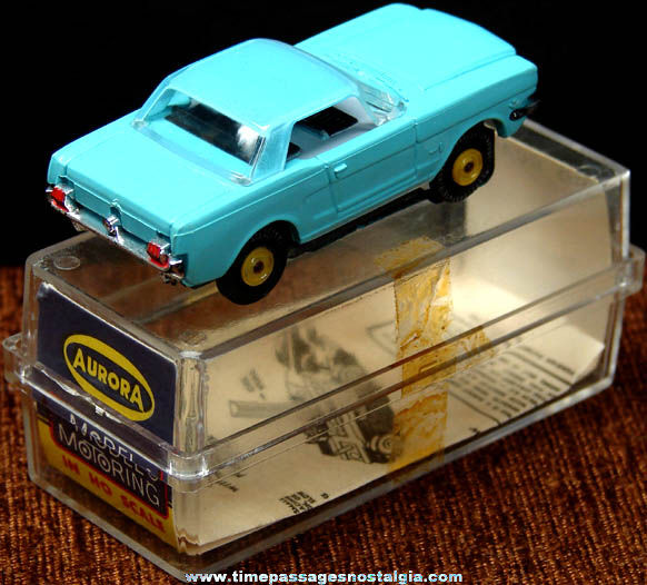 Boxed 1960s Turquoise Blue Ford Mustang Aurora Slot Car