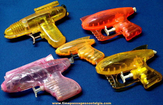 (5) Colorful Old Hard Plastic Squirt Space Ray Guns