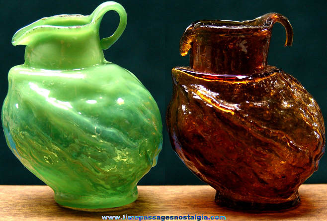 (2) Old Walnut Shaped Miniature Glass Pitchers
