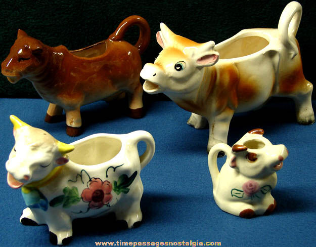 (4) Different Old Porcelain Cow Creamer Pitchers