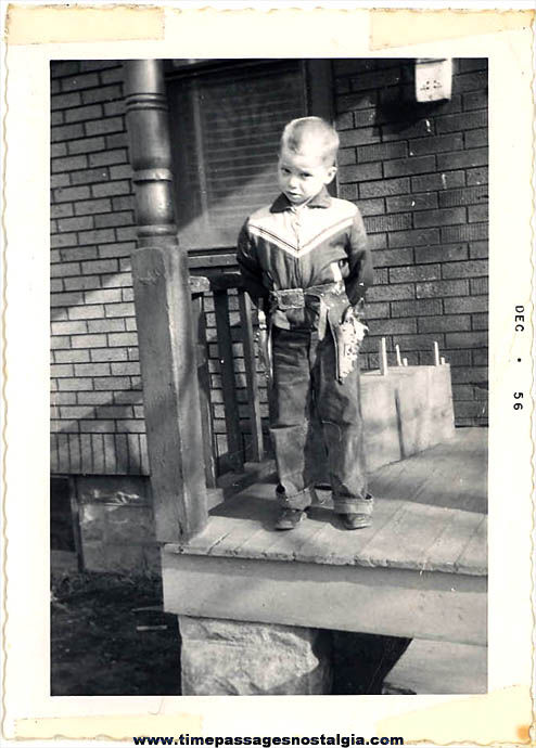 Boy In A Cowboy Outfit With Cap Guns December 1956 Photograph