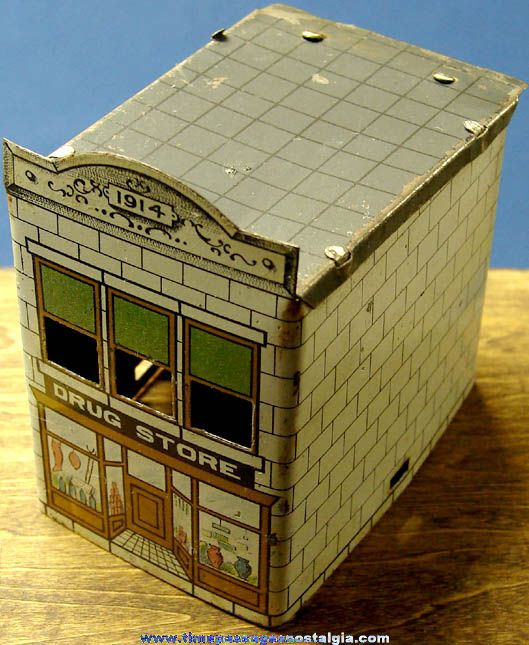 Old Miniature Lithographed Tin Drug Store Building Candy Container Toy