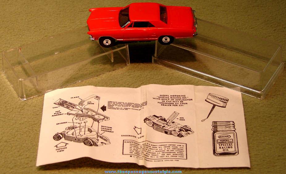 Boxed 1960s Red 1963 Buick Riviera Aurora Slot Car