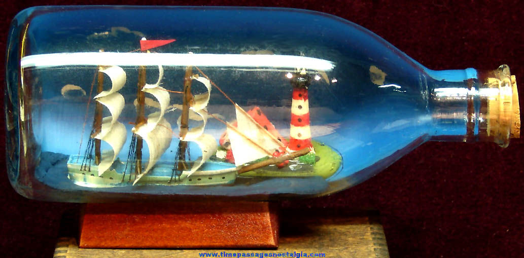 Small Sailing Ship and Light House In A Bottle