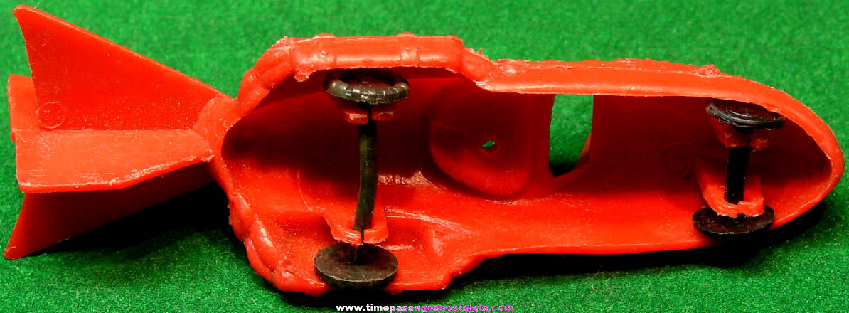 Old Miniature Novelty Red Plastic Toy Space Car