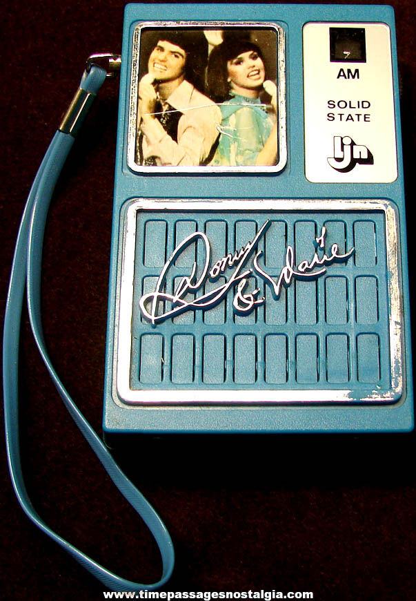 ©1977 Donny & Marie Osmond Pocket AM Transistor Radio with Strap