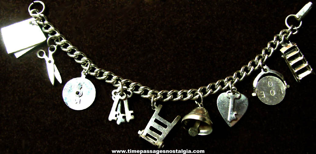 Old Silver Colored Metal Jewelry Charm Bracelet With (12) Charms