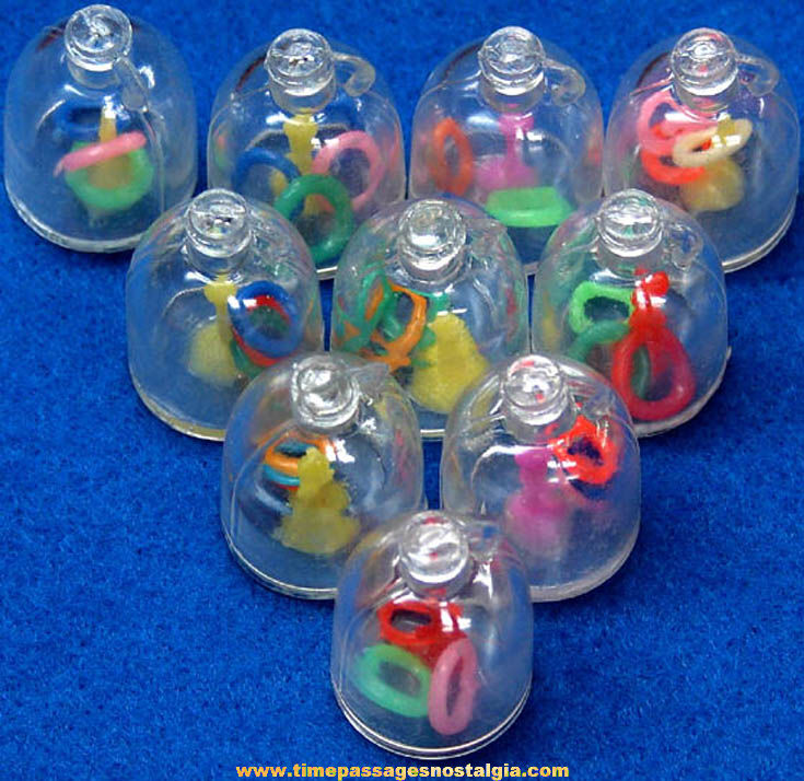 (10) Old Gum Ball Machine Prize Ring Toss Puzzle Toy Charms