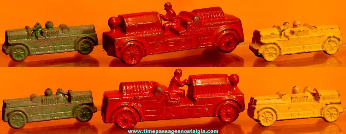 (3) Old Cracker Jack Pop Corn Confection Pot Metal or Lead Toy Prize Fire Engine Trucks