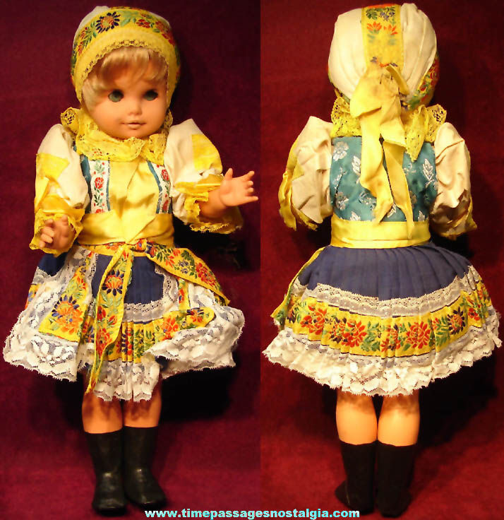 Old Unidentified Colorful Dressed Toy Blonde Girl Doll